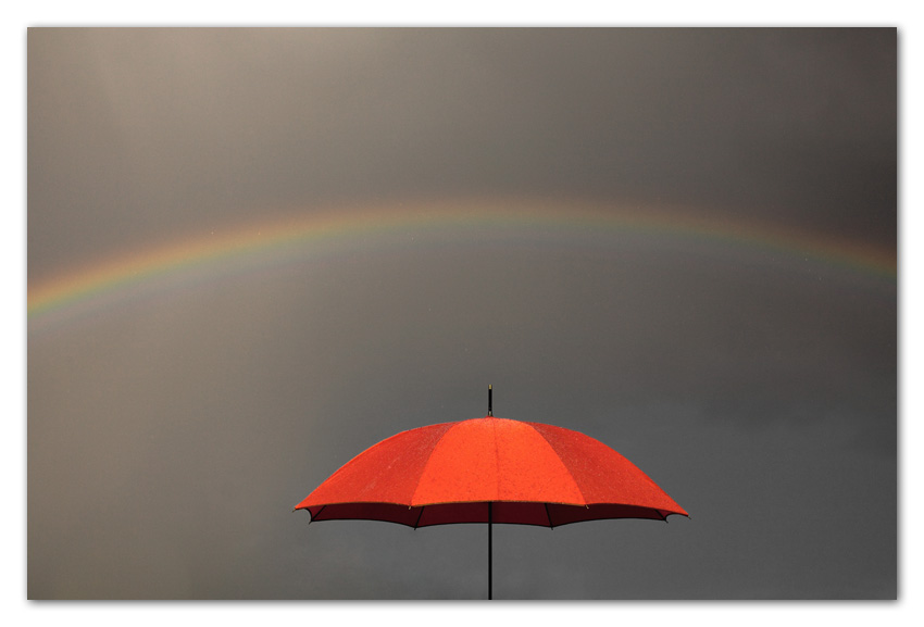 Rainbows over red umbrella Flagstaff Arizona