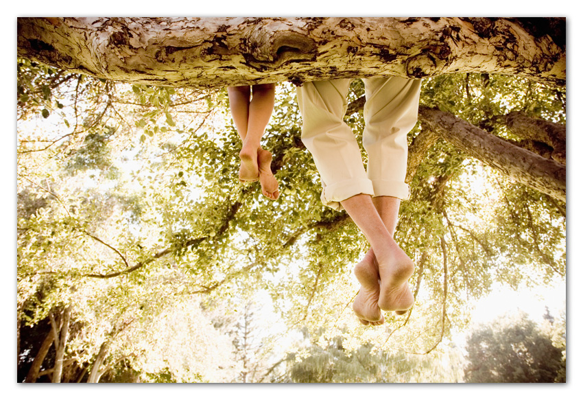 Feet of father and daughter hanging from tree Flagstaff Arizona